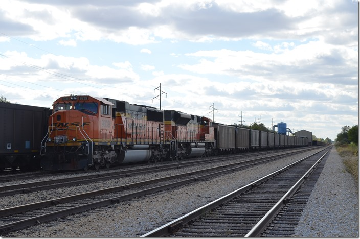 BNSF 9839-9288 on a train of CSUX hoppers. Ellis IL.