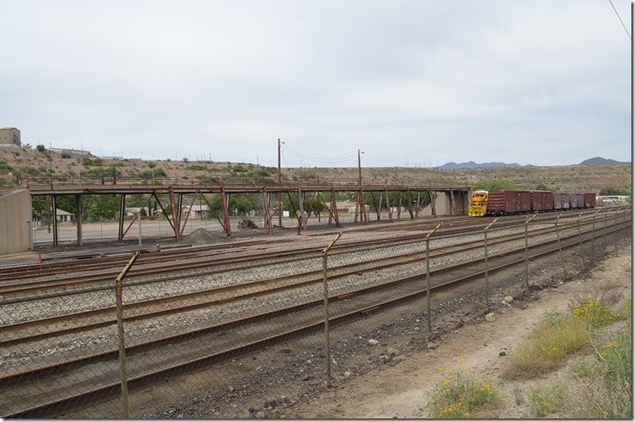 Arizona Eastern yard looking northeast. AZER B40-8 4010 in background. I don't know what the loading trestle was used for. Miami AZ.