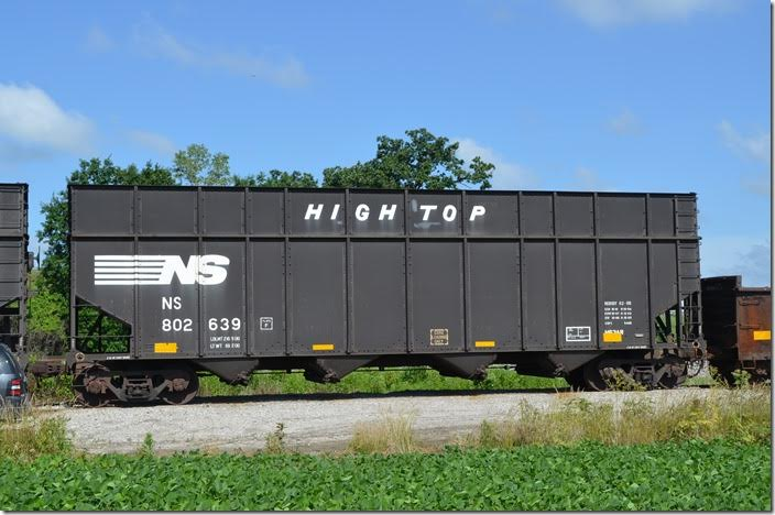 "NS ""High Top"" was converted from a standard hopper built 07-1978. It now has a volume of 5,465 cubic feet. NS class H63AR. Stored near Marion OH on 06-21-2015. This car is an ex-Con…CR 488445, to be precise. NS hopper 802639 Harvey OH."