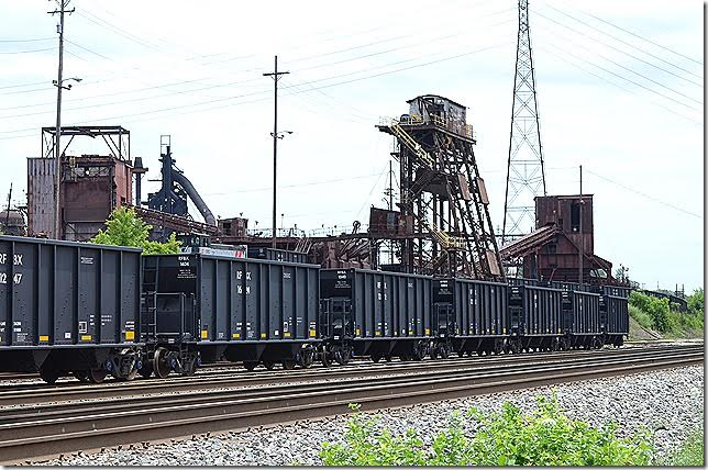 Looks like a switcher is shoving these cars up to the dumper. They could be carrying coke, taconite or limestone. Ashland KY 06-17-2015. RFBX hopper 1624 Ashland KY.