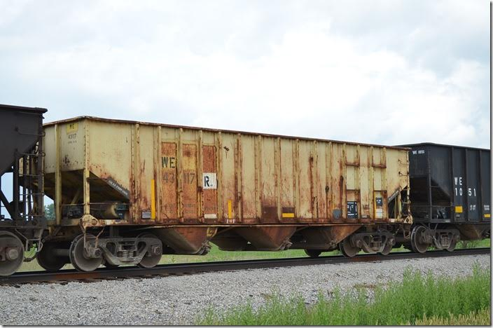WE 43117R is a former ICRX (Island Creek Coal) hopper that was built in N&W's Roanoke Car Shop, I think. It is restricted to home rails. Carey OH 06-18-2015. Its immediate previous identity was CMCX 43117 (Sweetman Construction Company). They may have been CMCX cars since 1991. These are significantly smaller than the ICRX cars, which went to AEX.
