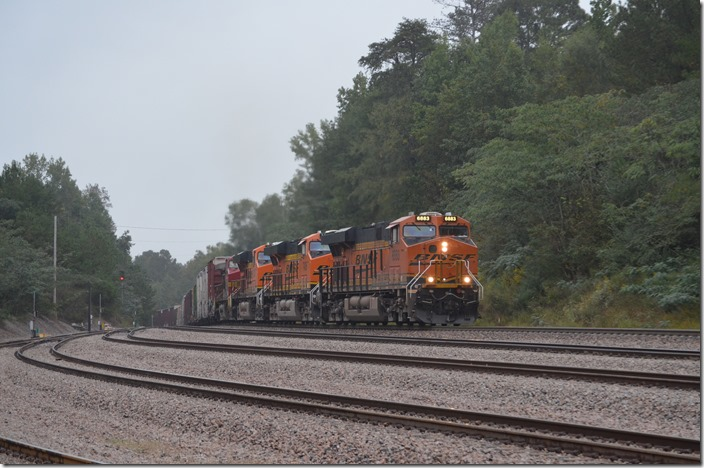 We heard the rumble of a train coming from the north and obviously straining up a heavy grade. NS's line from Birmingham to Memphis is nearby, but we were not to be disappointed. BNSF 6883-7426-6207-4705 lead this 107-car southbound manifest toward Birmingham. Quinton AL.