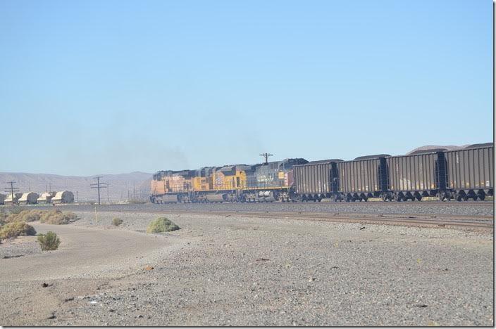 The coal train is not leaving town but pulling forward so the DPU helpers can be fueled. Those armored vehicles hint that the U. S. Marine Corps logistics base is just over there. There are several Marine, Army, USAF, and USN training bases nearby. UP 6511-8713-6318. Yermo CA.
