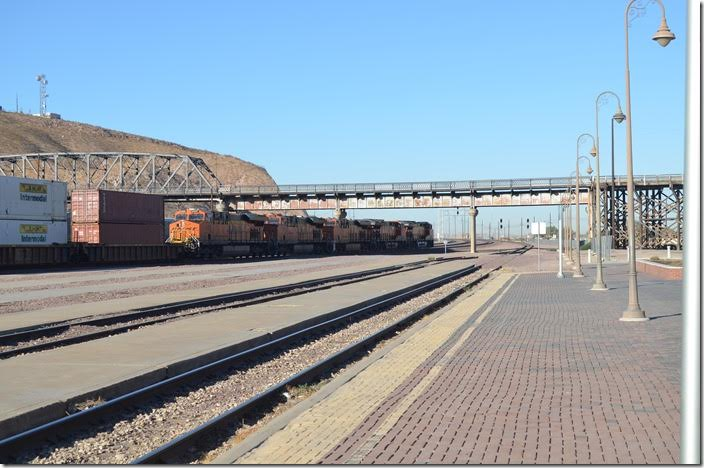BNSF 6329-7257-8031-3925-3969 are pulling to a stop with a w/b intermodal train. Barstow CA.
