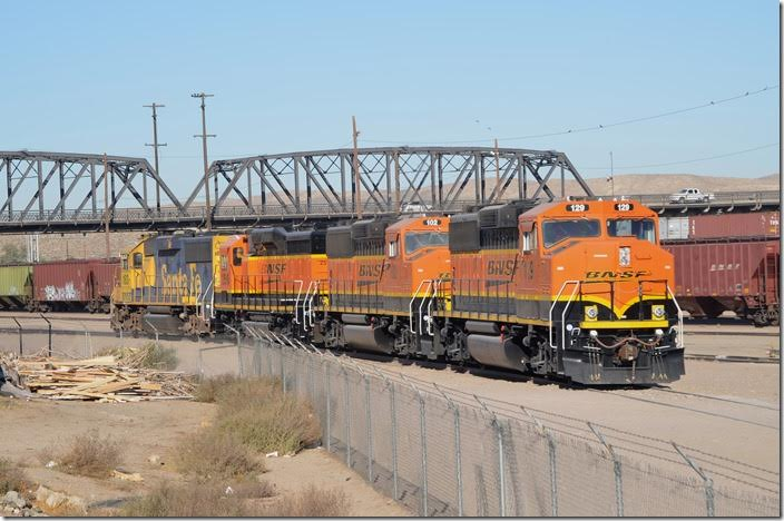 BNSF Geeps 129-102-2516-183 are parked on a lead that appears to have gone to the old roundhouse. Facilities east of the bridge appear to be part of the original yard. Barstow CA.