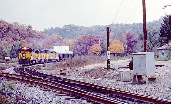 "The ""Scram"" mine run starting up the SC&M with 140 empties. 10-24-86."