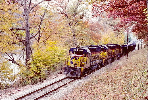 At Camden-On-Gauley we found Chessie System GP40-2s 4147-4327-4136 sitting on the main with a string of empty hoppers.