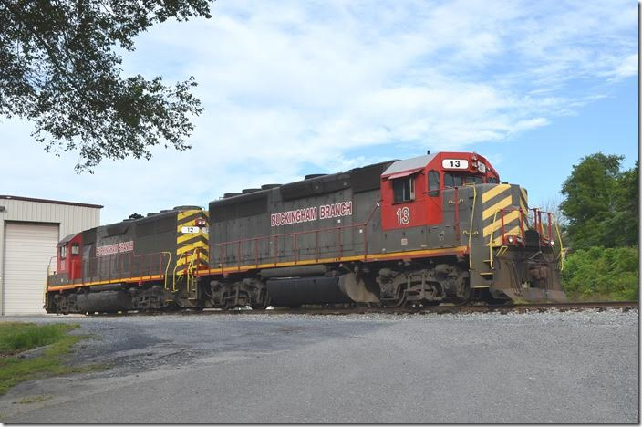 "Buckingham Branch ""GP40-3s"" 13 and 12 parked on Sunday morning, 08-02-2015, at their ""C&O Flats"" yard in Staunton. No. 13 was originally Milwaukee Road; 12 started work as Penn-Central. Both were also used by KCS. Staunton."