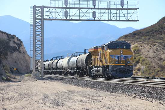 UP 8231, a GM SD90/43AC, is no longer pushing its train of oil tank cars but instead is providing dynamic braking as its 90 car unit tank train descends the west side of Cajon Pass.