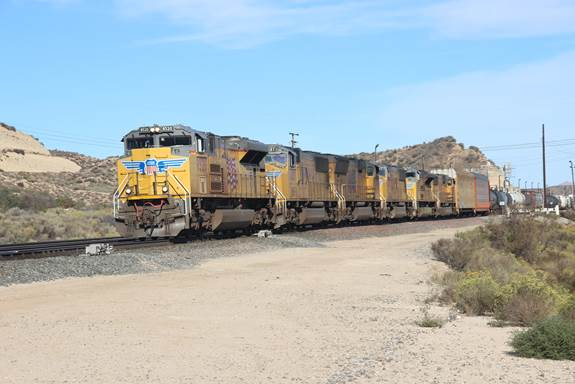 This Union Pacific mixed freight is running westbound on BN-SF's Track #3.
