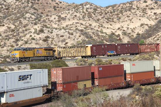 UP 8159, an EM SD70ACE, in pusher service, is at CP SP468 heading up the west slope of Cajon Pass.