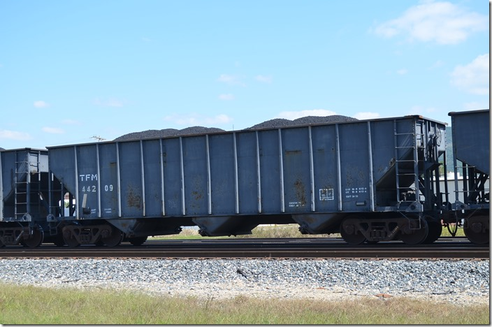 TFM (Kansas City Southern de Mexico) hopper 44209 has a volume of 3433 cubic feet. This coal was heading south in the consist of a freight. Heavener OK.