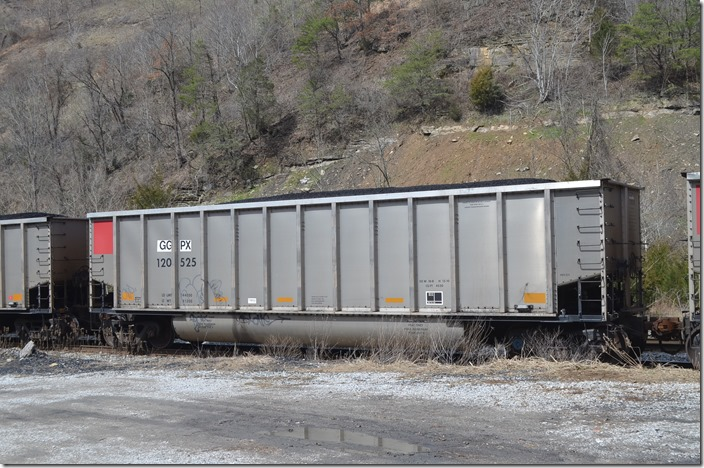 GGPX (General American Marks) tub 120525 was built by Freight Car America and has a volume of 4520 cubic feet. It is moving on the SV&E SD at Esco KY on 03-21-2015.