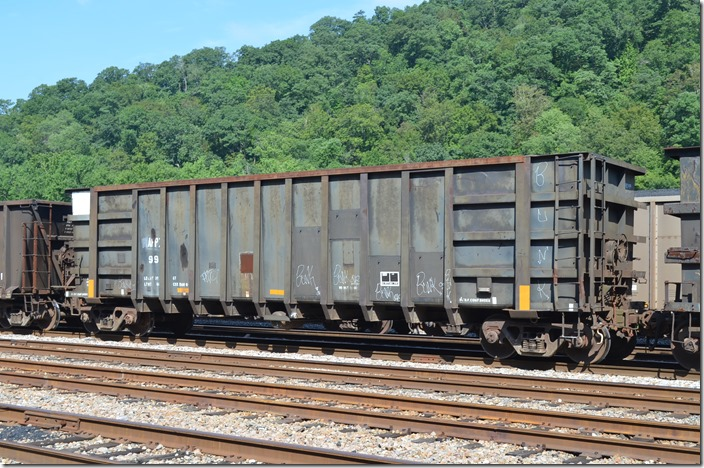 APPX gon 99 (Appalachian Railcar Services), built 10-1977, rebuilt 09-1990. In scrap tie service at Shelby KY, 07-25-2015.