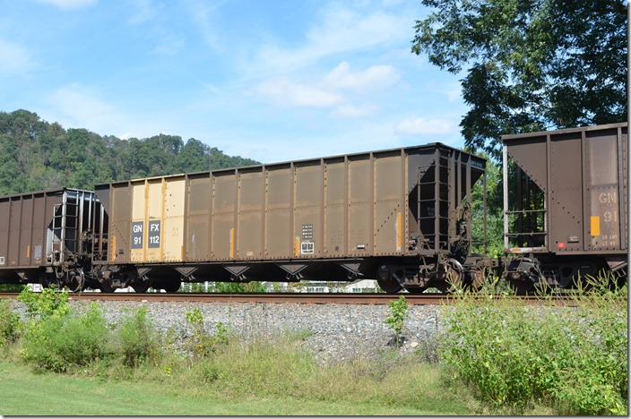 GNFX hopper 91112 (City of Gainesville, FL) has a load limit of 233,700 and a volume of 4000 cubic feet. It was built by Trinity in 09-1992. On westbound empty train leaving Shelby on 09-19-2015. Fords Branch.