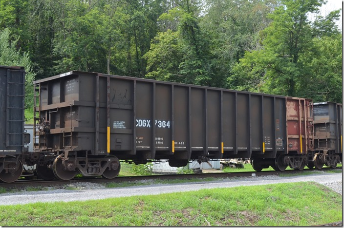 COGX (Rail Connection Inc.) gon 7364, ex-PSCX 364, 203,900, 4000 cu ft, blt 10-1975. In scrap tie service on Appalachian & Ohio RR at Burnsville WV. 07-27-2016.
