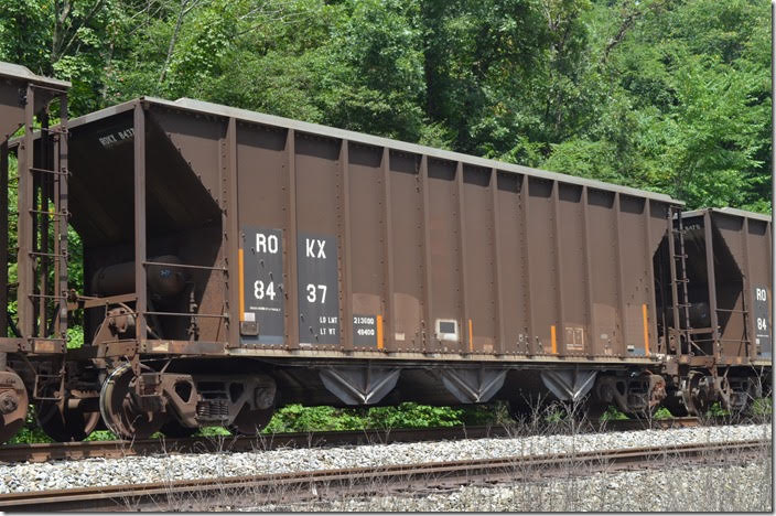 ROKX hopper 8437 is also 213,100 load limit, 3283 cu ft and built 11-1984. This southbound unit stone train is parked on the former VGN at Kellysville WV. It was loaded by Boxley in Princeton yard and is going to the Hyco NC power plant for use in scrubbers.