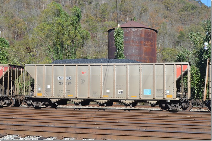 Sister car. That old water tank is the last steam-era servicing structure left at Shelby KY. It is being eaten by kudzu! MILX hopper 25194.