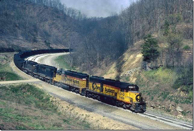 C&O 7426-7423-7502-7430 on Coal Run Shifter grinding up grade almost to tunnel at head of Millers Creek. 04-1982. Coal Run SD.