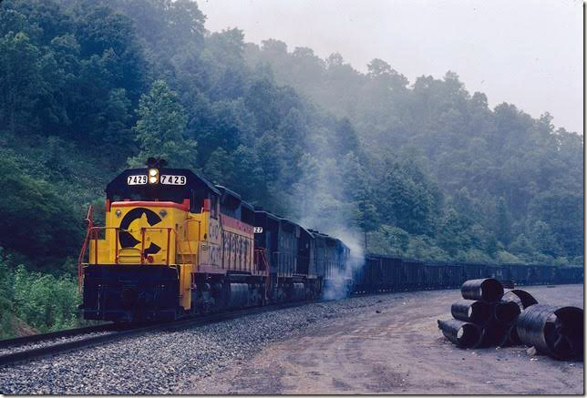 C&O 7429-7427-7428 stalled with 82 loads on grade because of failed traction motor.  Coal Run SD.