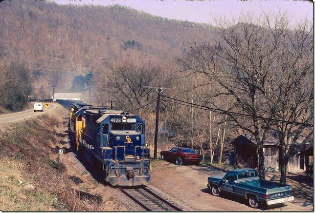 C&O 4826-4284-4182 head up the Long Fork SD at Salisbury (Printer, KY post office) with empties. 02-1981. The spur to the Spurlock Mine crossing the bridge in the background is very active, but the rest of the line to Price has been inactive for years. Dawkins Middle Crk SD.