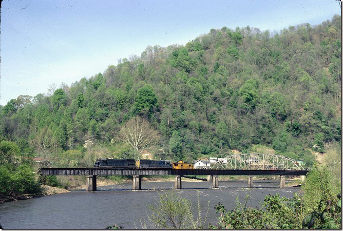 After leaving their empties at the West Gilbert tipple, Extra 8205 crosses the Guyandotte River. This is N&W track from West Gilbert to Gilbert Yard. VGN never used it for anything, but undoubtedly wanted it in place to obstruct C&O expansion on up the river. It worked. It is still in place although inactive for many years. C&O Logan, Buffalo, IC SD.