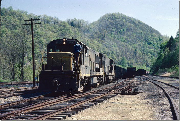 "The ""N&W Shifter"" gets ready to depart N&W's Gilbert Yard with loads from various ""joint"" mines along the Guyandotte River between here and Itmann. C&O Logan, Buffalo, IC SD."