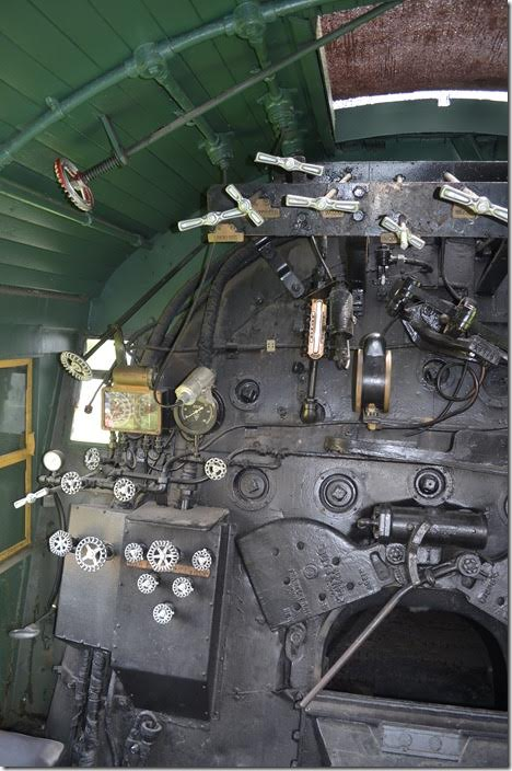 The triangular configured knobs are the stoker distributor valves that blow coal to various locations in the fire box. C&O 1308. Backhead.