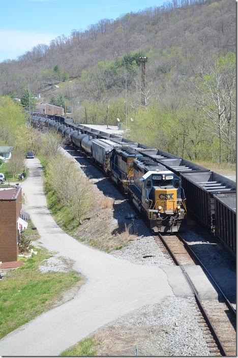 CSX 8388-8853. View .2 Shelby. K446-07 departs on the main as an empty train arrives up the yard lead.