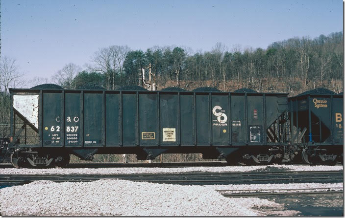 "C&O hopper 62837 Shelby KY. 03-09-1986. ""Green coke loading only"". The car is in coal service. (All of the coke I've seen was gray!)"