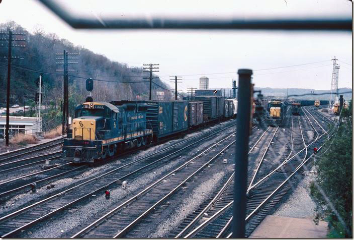 "7303 switches the eastbound (""Big Four"") yard. Note the position light switching signal. 11-10-1977. RU Cabin."