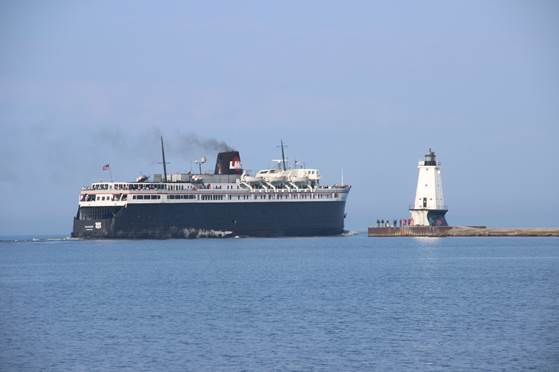 Badger is seen the next morning leaving Ludington.