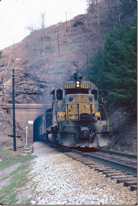 CRR 3006-200-800-2005 exits Perkins Tunnel with #26. 04-02-1978.