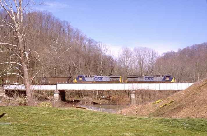 CSX AC44s 242-380 have just left Loyall Yard and are crossing the Cumberland River at Baxter, Ky.