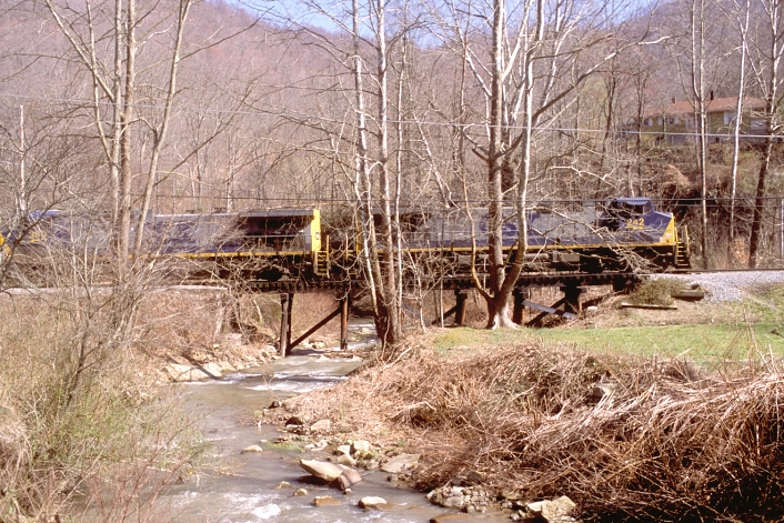 Crossing the creek on a small trestle at Stanfill, Ky.