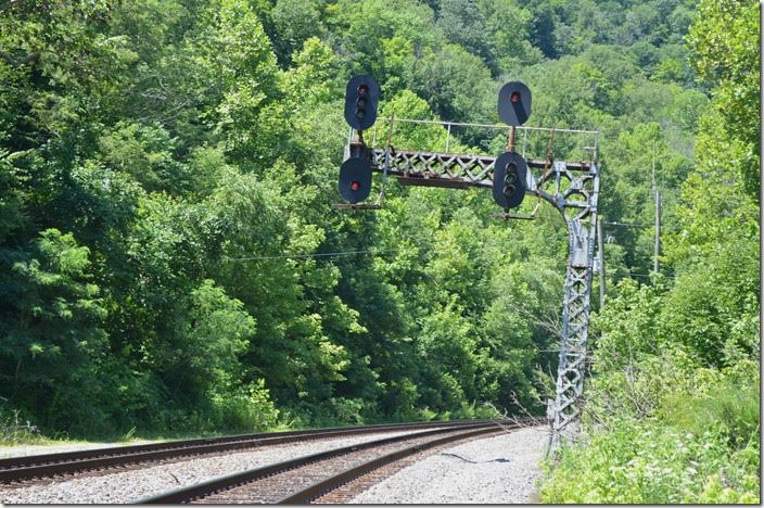 CSX medium clear signal at FO Cabin for a westbound on the No. 1 main to single track. If you think the cantilever signal is leaning slightly it is. A big derailment here in the late 1960s hit it.