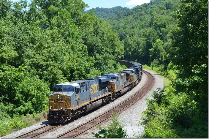CSX 712-266-3190-3449 have w/b empty DKPX (Duke Energy) hopper train E760-06 on their way to Russell. 07-08-2018. FO Cabin KY.