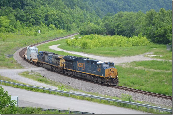 "CSX 3284-9002 handled this ""high & wide"" load W799-08 e/b by FO Cabin on 06-09-2018. This is the reclaimed site of the Chaparral Coal Co. prep. plant in earlier times."