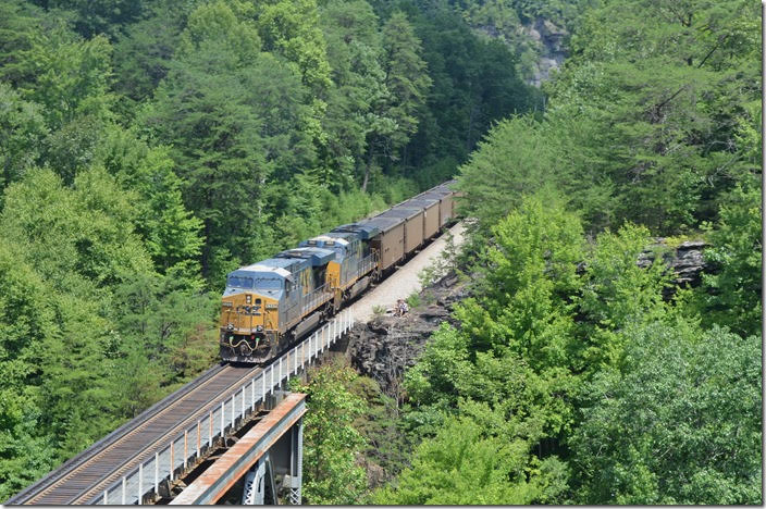 The two young couples have wisely paused their hiking until the coal train clears. CSX 5345-993. View 2. Pool Point KY. DPU.