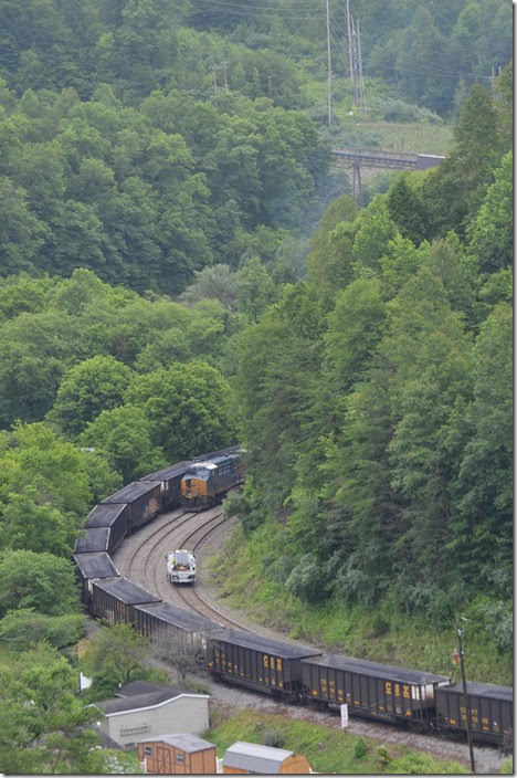 A track inspector rolls by on the main heading up the creek. CSX 901. View 3. Bevins Branch Mine KY.