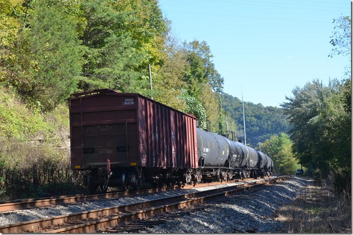 This BNSF was stenciled as a buffer car. Practically all ethanol trains we see are empty going west toward Russell. CSX 91-820. View 2. EE Pauley KY.