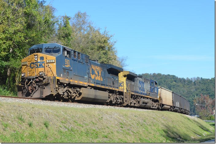 CSX 593-39 on e/b U209-18 with 100 empty tubs held back at the west end of Pauley until K446 passed, so as not to block crossings. U209 is now moving up the siding expecting a medium clear at the east end of Pauley KY. 10-19-2018.