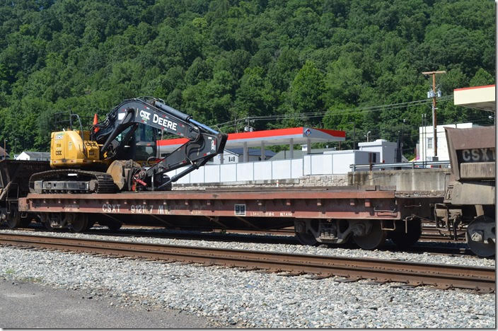 CSX flat 912107 with John Deere backhoe. Danville WV. 06-24-2018.