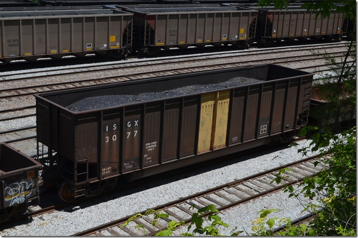 This old Bethlehem Steel coke car was full of debris at Shelby. ISGX is Arcelor Mittal now. They operate former Bethlehem mills. These used to be fairly common unit trains on the former C&O and Conrail. Around here they would haul coal, and can only be loaded to the level shown in this photo.