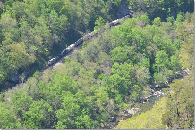 From last Sunday, 4-27-14, at the Breaks Interstate Park. Southbound loaded grain train behind 7657 with 90 cars and a two unit pusher from the State Line Overlook. The train is coming out of State Line Tunnel.