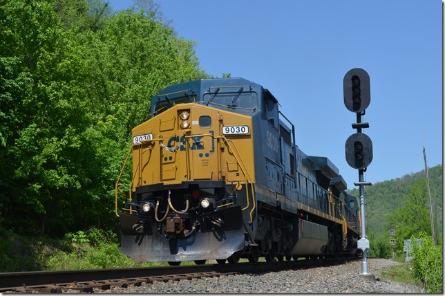 CSX 9030-7924 depart with 47 empty ballast hoppers. View 2.
