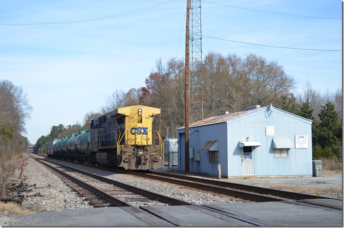 CSX 228 southbound local out of Bostic Yard passing Chesnee SC, on the Blue Ridge SD (former CRR). This and coal trains going to the Cliffside Power Plant (Duke) are all that use this once busy line now. 12-06-2015.