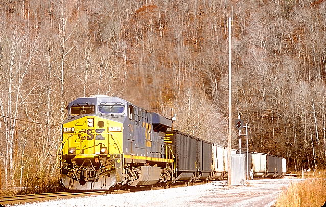 Going up Pond Fork of Coal River, I overtook CSX shifter H837-18 eastbound.
