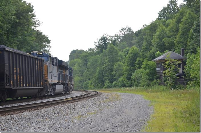 T051 is picking up speed at West End (0.5%) and the pusher throttles down. West End Tower has been closed many years, but I've visited the operators there. CSX pusher 3254-780 West End WV.
