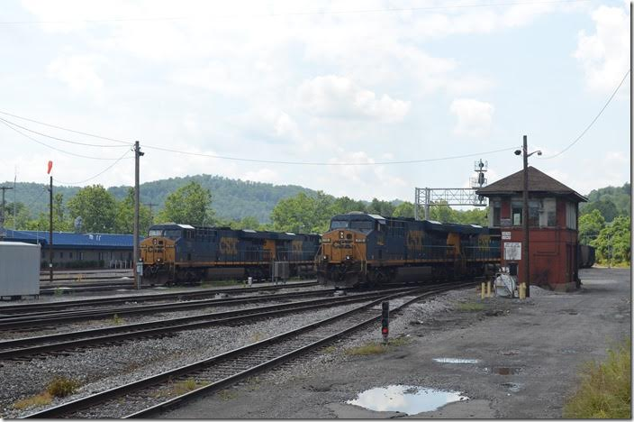 Just as I arrived in Grafton in the early afternoon, this coal train was pulling slowly under the highway bridge off the Fairmont SD. That gave me a minute or two to get this photo of T051-24 eastbound passing D Tower. On the left is the yard office. CSX 719-720. Grafton WV.